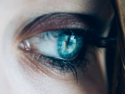 Bright blue woman's eye staring at the camera