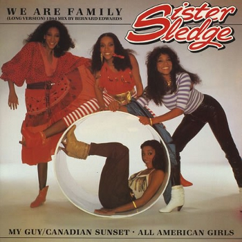White/grey cover of the sleeve for Sister Sledge's 'We are Family' (also featuring My 'Guy/Canadian Sunset' and 'All American Girls'). This shows the band and a white circular tube. Kathy sits on the tube with Debbie to her left and Joni to her right (top) while Kim sits inside it