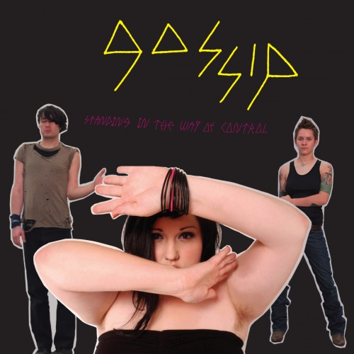 Gossip's Standing in the Way of Control (album cover). Black background. Brace Paine standing with his eyes shut and his left arm bent at the elbow (left, back), Beth Ditto with a braceletted left arm over her head and right arm across her chin (Middle, front) and Hannah Blilie standing astride (back, right). Bandname in jagged yellow writing (top middle) and title in smaller jagged dark pink letters (middle)