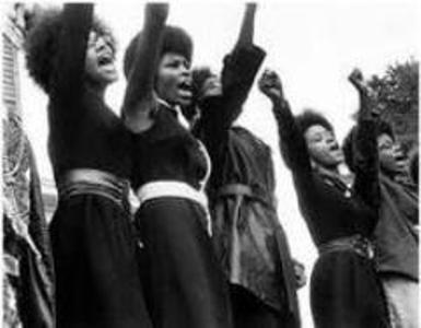 black and white photo of black women raising fists and shouting in protest
