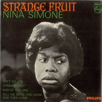 Cover of Nina Simone's 1965 'Strange Fruit' EP on the Philips label. Green and orange writing over a dark grey sleeve overlaid with a black and white head and shoulders image of an unsmiling Nina Simone looking over her left shoulder
